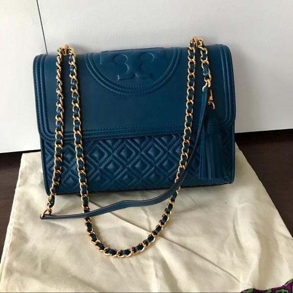 db7f57991b7d Tory Burch Fleming Convertible Shoulder Bag. M 5a3c2a62a825a6c169005491.  Other Bags ...